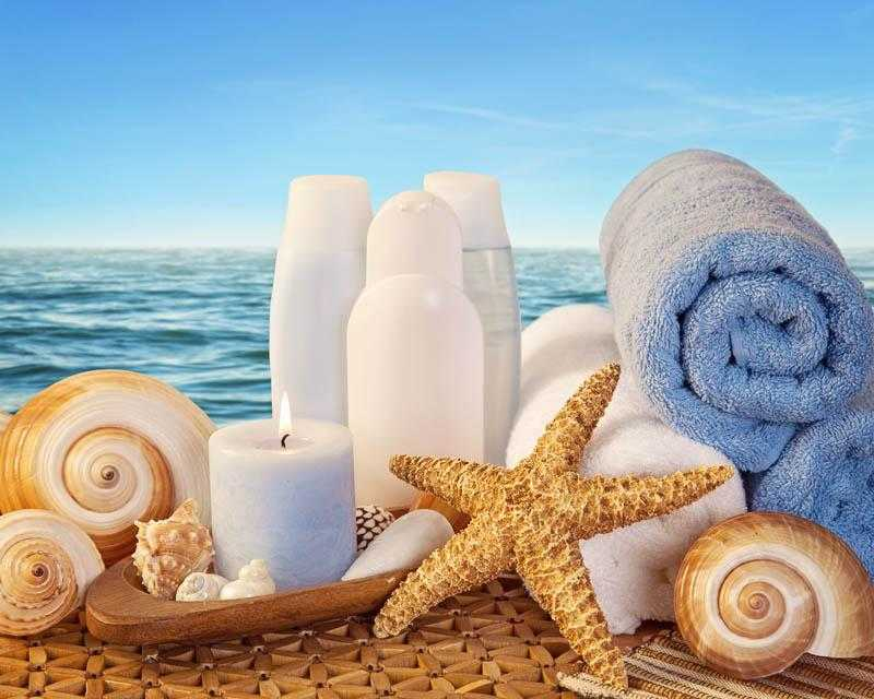 Spa elements with white towels,candle and brown bottles